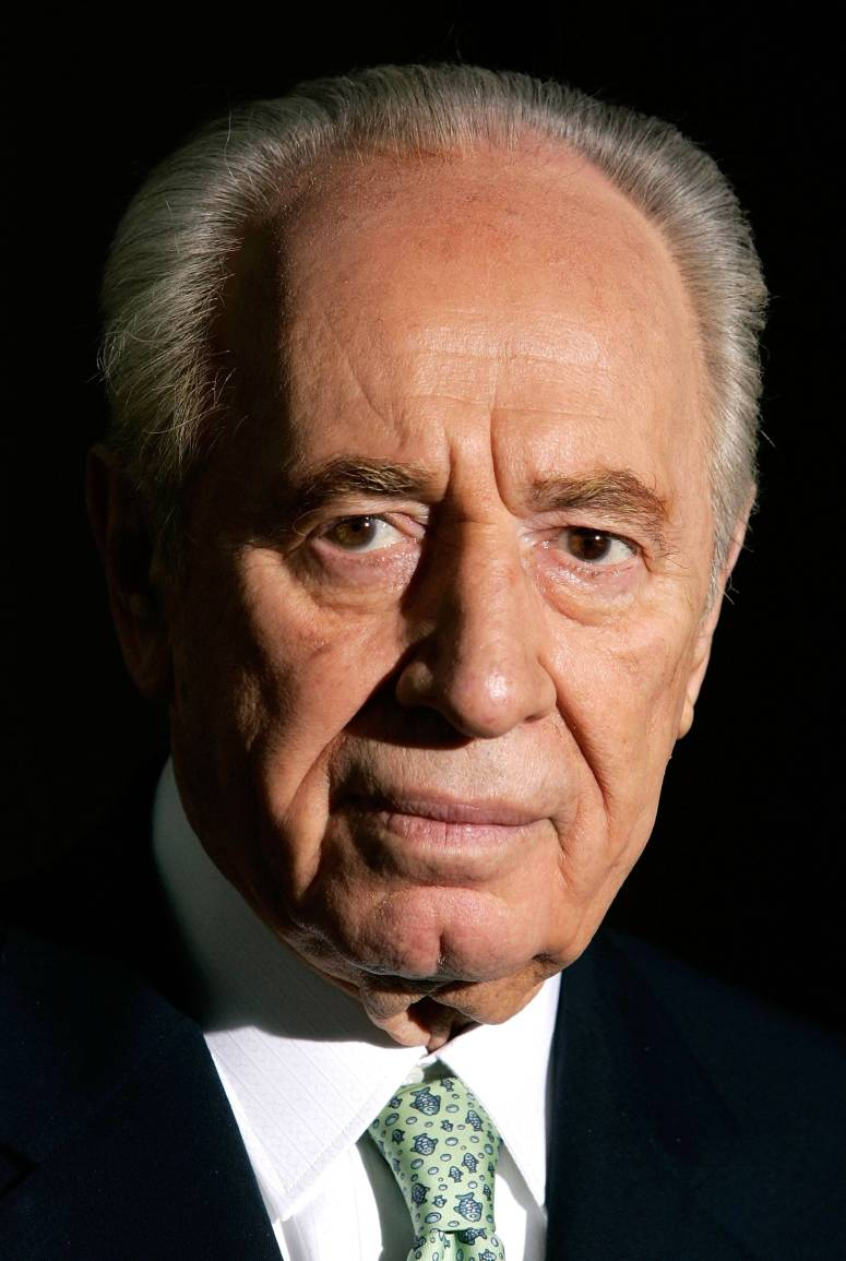 WASHINGTON - JANUARY 18: Former Israeli Prime Minister Shimon Peres pauses as he speaks to the media after a meeting with U.S. Secretary of State Condoleezza Rice at the State Department January 18, 2006 in Washington, DC. Peres had resigned from the Israeli parliament before he started his trip to the United States. (Photo by Alex Wong/Getty Images)